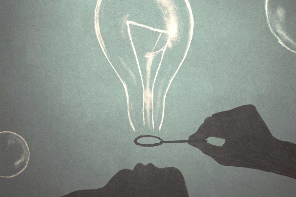 シャボン玉で電球をつくっている