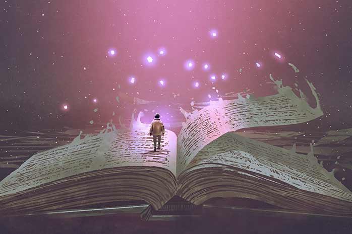 本から舞い上がる光を見つめる少年